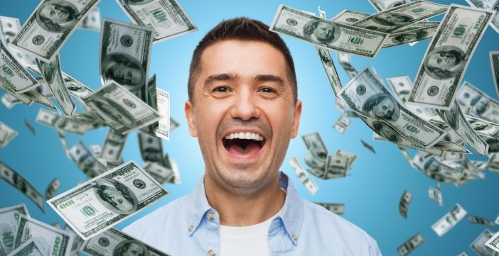 laughing man with falling dollar money
